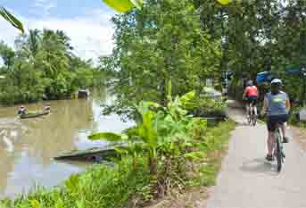 BIKING - CRUISING FULL DAY  - SAIGON RIVER - CU CHI TUNNELS